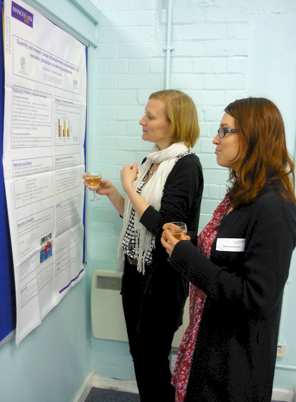 Researchers reading a research poster